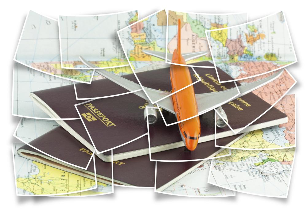 miniatura samolotu na mapie świata i na paszporcie